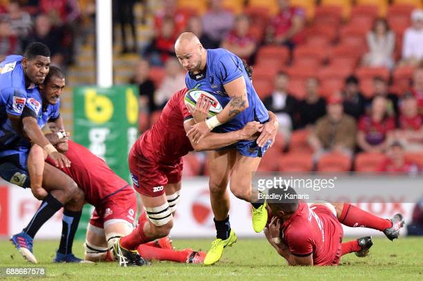 Billy Meakes of the Force breaks through the defence during the round 14 Super Rugby match between the Reds and the Force at Suncorp Stadium on May...
