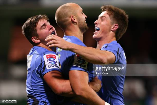 Billy Meakes of the Force celebrates a try with Richard Hardwick and Alex Newsome during the round 16 Super Rugby match between the Force and the...
