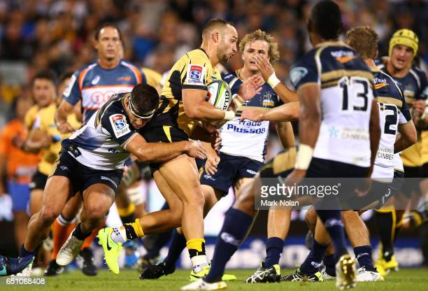 Billy Meakes of the Force is tackled during the round three Super Rugby match between the Brumbies and the Force at GIO Stadium on March 10 2017 in...