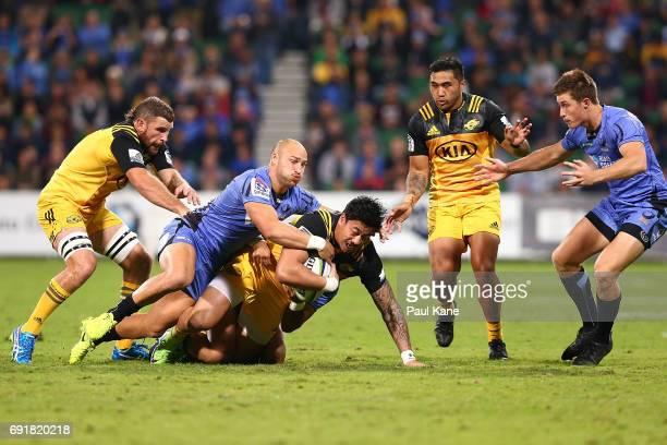 Billy Meakes of the Force tackles Ben Lam of the Hurricanes during the round 15 Super Rugby match between the Force and the Hurricanes at nib Stadium...