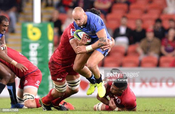 Billy Meakes of the Force takes on the defence during the round 14 Super Rugby match between the Reds and the Force at Suncorp Stadium on May 26 2017...