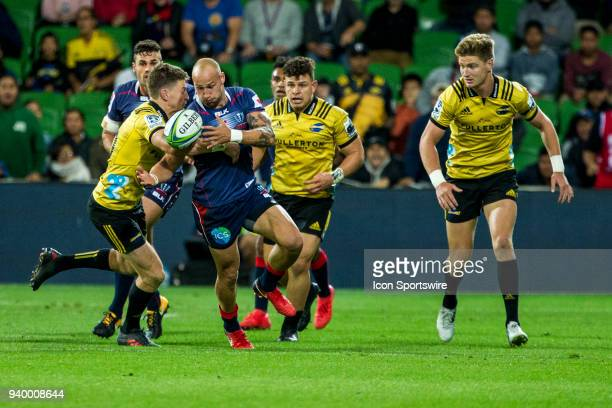 Billy Meakes of the Melbourne Rebels is tacklde by Beauden Barrett of the Wellington Hurricanes during Round 7 of the Super Rugby Series between the...