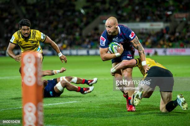 Billy Meakes of the Melbourne Rebels is tackled by Jordie Barrett of the Wellington Hurricanes during Round 7 of the Super Rugby Series between the...