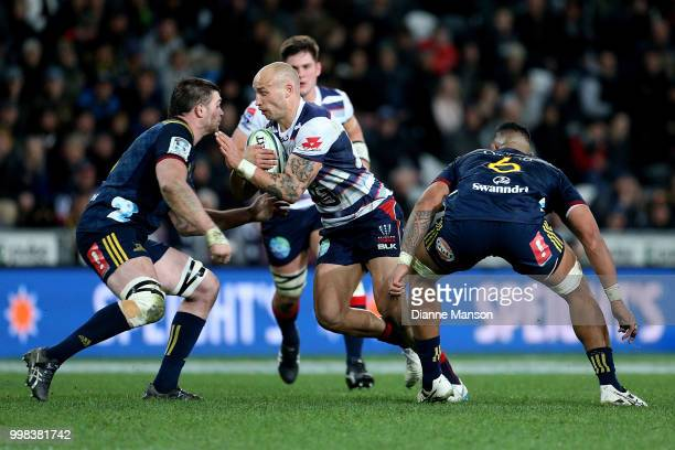 Billy Meakes of the Rebels fends off Liam Squire of the Highlanders during the round 19 Super Rugby match between the Highlanders and the Rebels at...