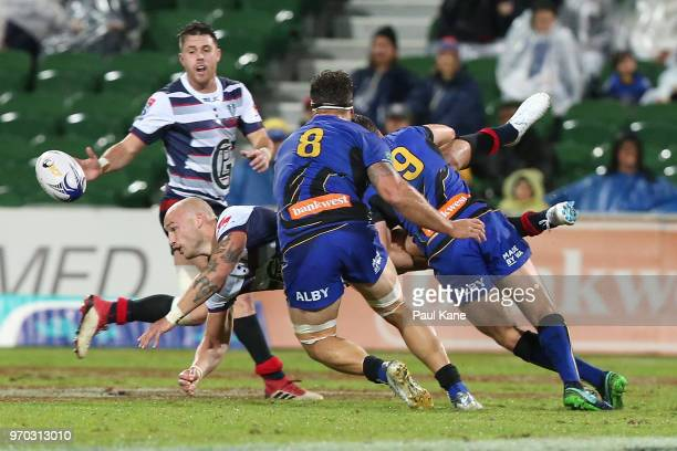 Billy Meakes of the Rebels gets tackled by Ian Prior of the Force during the World Series Rugby match between the Force and the Rebels at nib Stadium...
