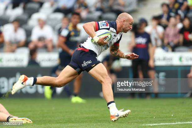 Billy Meakes of the Rebels makes a break during the round five Super Rugby match between the Highlanders and the Rebels at Forsyth Barr Stadium on...