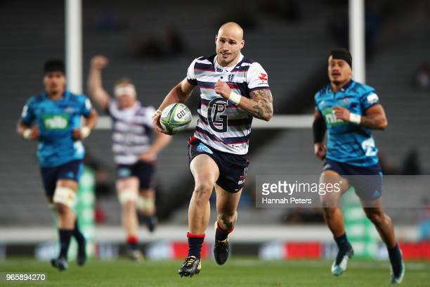 Billy Meakes of the Rebels runs away to score a try during the round 16 Super Rugby match between the Blues and the Rebels at Eden Park on June 2...