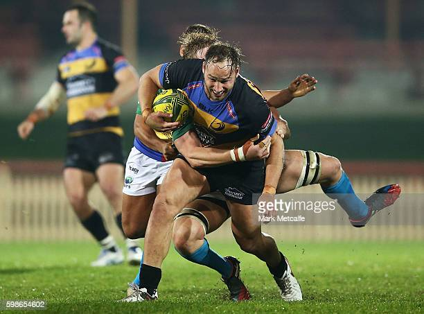 Billy Meakes of the Spirit is tackled during the round two NRC match between the Sydney Rays and the Perth Spirit at North Sydney Oval on September 2...