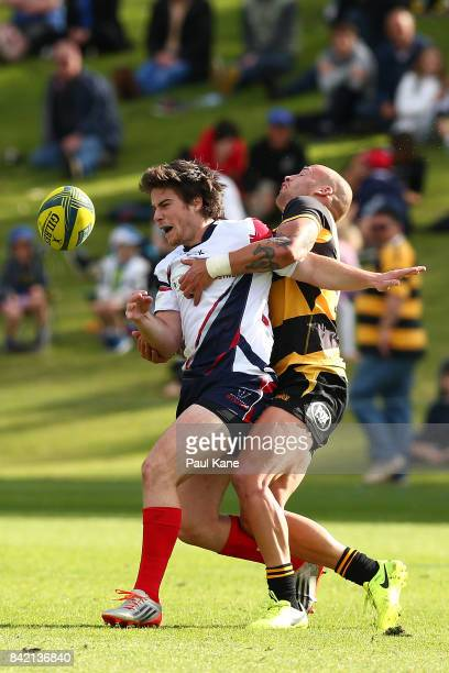 Billy Meakes tackles Jack McGregor of the Rising during the round one NRC match between Perth Spirit and Melbourne Rising at McGillivray Oval on...