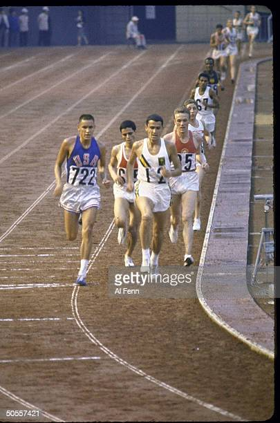 Billy Mills of the US wins the 10000 meters run at Summer Olympics