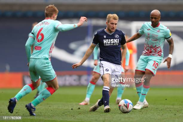Billy Mitchell of Millwall FC is put under pressure by Andre Ayew of Swansea City and Jay Fulton of Swansea City during the Sky Bet Championship...