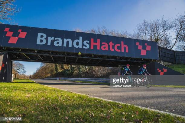 Billy Monger joined by his trainer, Andy Wellfare, cycling and walking 41 miles around the Indy Circuit at Brands Hatch, on the 26th February 2021 in...