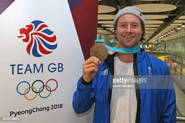 Billy Morgan of Great Britain poses with his Men's snowboarding big air bronze medal during the Team GB Homecoming from the Winter Olympics at...