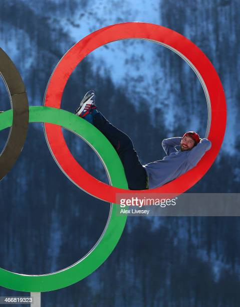 Billy Morgan of the Great Britain Snowboard Team poses for a portrait on the Olympic rings at the Athletes Village in the Rosa Khutor mountain...