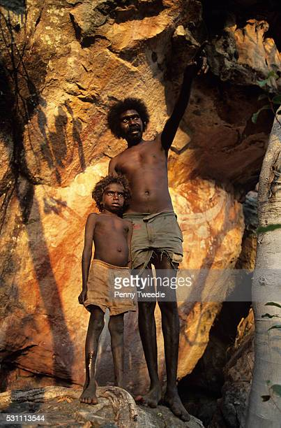 Billy Nalakandi and son Romeo at Dirdbim the site of the Moon Dreaming created by Ngalyod the rainbow serpent in creation times central Arnhem Land...