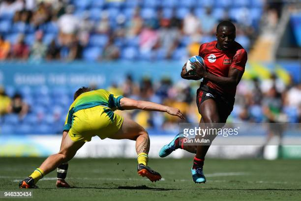 Billy Odhiambo of Kenya takes on Ben O'Donnell of Australia during the Rugby Sevens Men's Placing 58th match between Australia and Kenya on day 11 of...