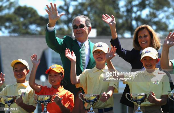Billy Payne Chairman of Augusta National Golf Club is pictured with participants during the Drive Chip and Putt Championship at Augusta National Golf...