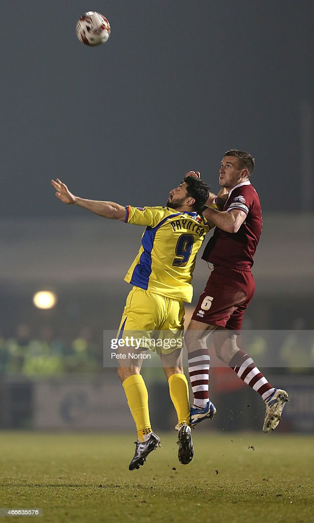 Billy Paynter of Carlisle United contests the ball with Lee Collins of Northampton Town during the Sky Bet League Two match between Northampton Town and Carlisle United at Sixfields Stadium on March 17, 2015 in Northampton, England.