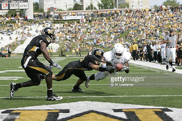 Billy Pittman of the Texas Longhorns dives in for a touchdown during a game against the Missouri Tigers at Memorial Stadium in Columbia Missouri on...
