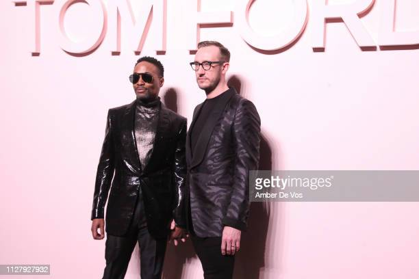 Billy Porter and Adam Smith attend Tom Ford FW19 Fashion Show at Park Avenue Armory on February 06 2019 in New York City