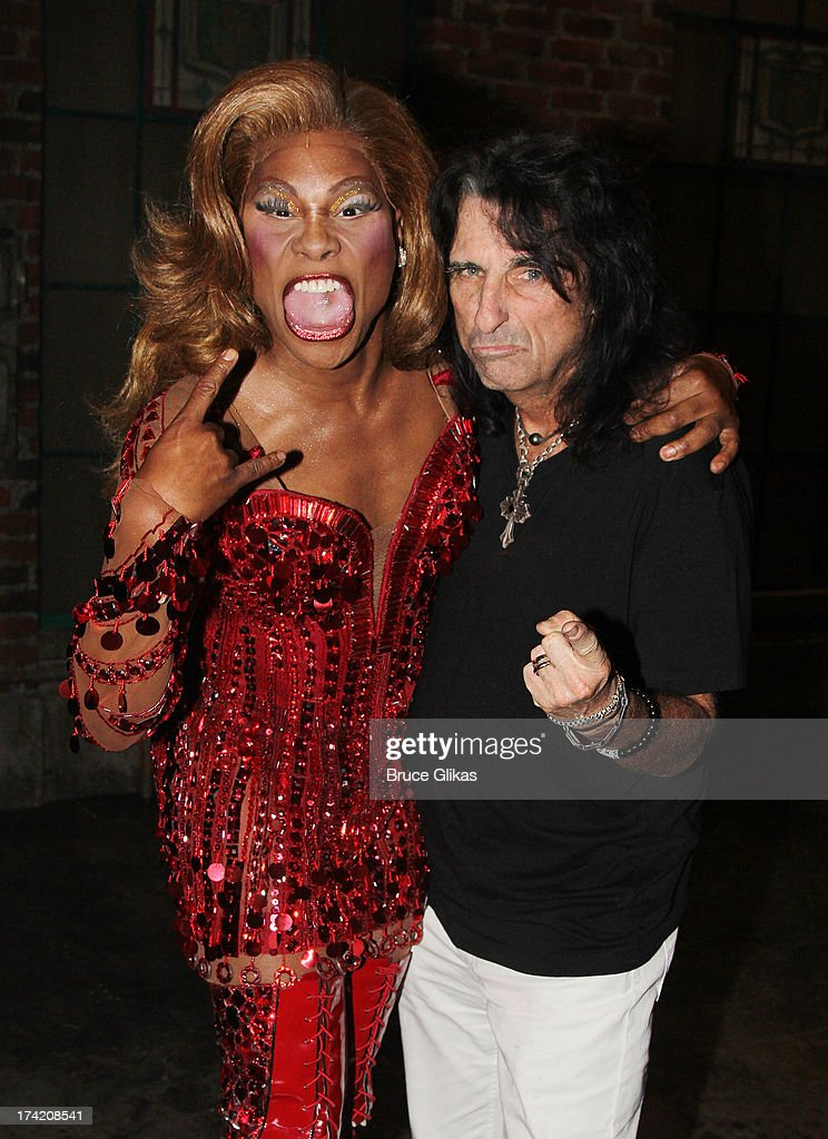 Billy Porter as 'Lola' and Alice Cooper pose backstage at the musical 'Kinky Boots' on Broadway at The Al Hirshfeld Theater on July 21, 2013 in New York City.