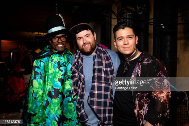 Billy Porter, designer Richard Quinn and stylist Sam Ratelle pose for photos backstage after 'Richard Quinn S/S 2020' fashion show during London...