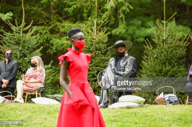 Billy Porter watches as a model walks during the Christian Siriano Collection 37 2020 Fashion Show on September 17 2020 in Westport Connecticut