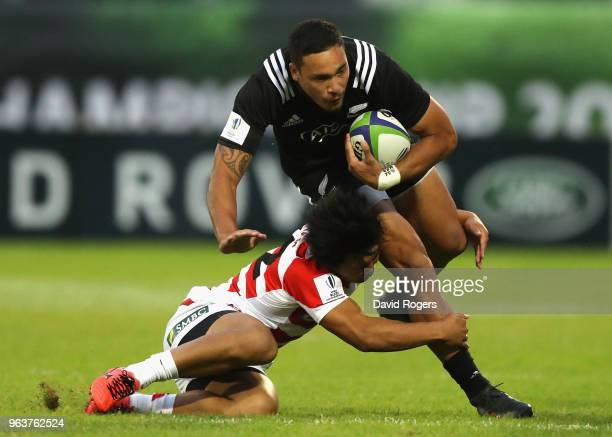 Billy Proctor of New Zealand is tackled by Yuto Mori during the World Rugby U20 Championship match between New Zealand and Japan at Stade d'Honneur...