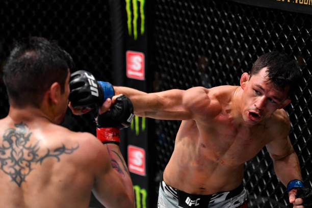 Billy Quarantillo punches Gabriel Benitez of Mexico in their featherweight bout during the UFC Fight Night event at UFC APEX on July 17, 2021 in Las...