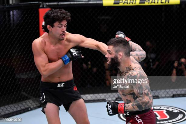 Billy Quarantillo punches Gavin Tucker of Canada in their featherweight bout during the UFC 256 event at UFC APEX on December 12, 2020 in Las Vegas,...