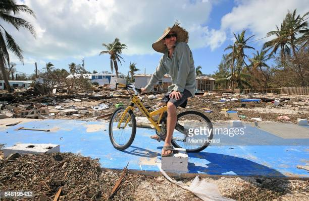 Billy Quinn sits on his bike and the concrete slab where his trailer once stood at the Seabreeze trailer park along the Overseas Highway in the...