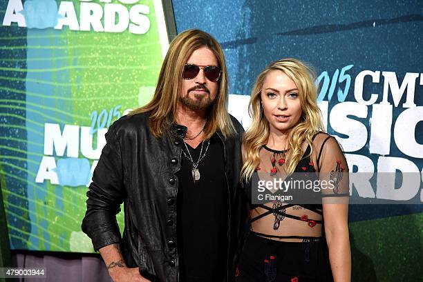 Billy Ray Cyrus and Brandi Glenn Cyrus attend the 2015 CMT Music awards at the Bridgestone Arena on June 10 2015 in Nashville Tennessee