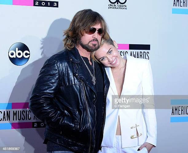 Billy Ray Cyrus and daughter Miley Cyrus arrive at the 2013 American Music Awards at Nokia Theatre LA Live on November 24 2013 in Los Angeles...