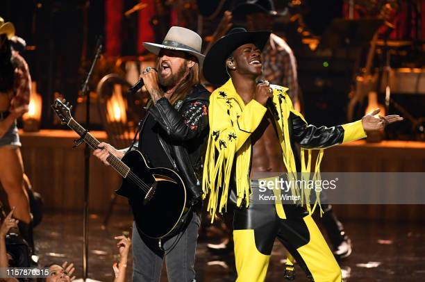 Billy Ray Cyrus and Lil Nas X perform onstage at the 2019 BET Awards on June 23 2019 in Los Angeles California