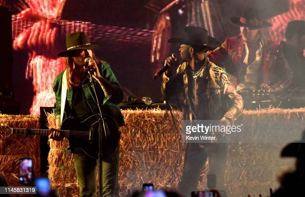 Billy Ray Cyrus and Lil Nas X perform onstage during the 2019 Stagecoach Festival at Empire Polo Field on April 28, 2019 in Indio, California.