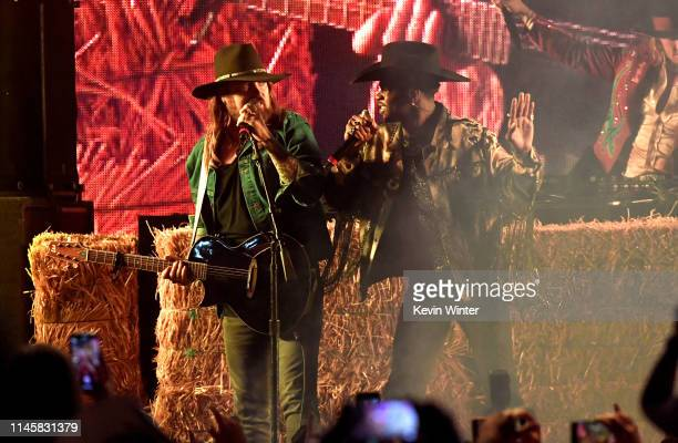 Billy Ray Cyrus and Lil Nas X perform onstage during the 2019 Stagecoach Festival at Empire Polo Field on April 28 2019 in Indio California