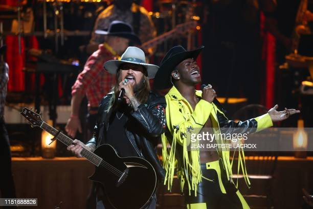 Billy Ray Cyrus and Lil Nas X perform onstage during the 2019 BET awards at Microsoft Theater in Los Angeles California on June 23 2019