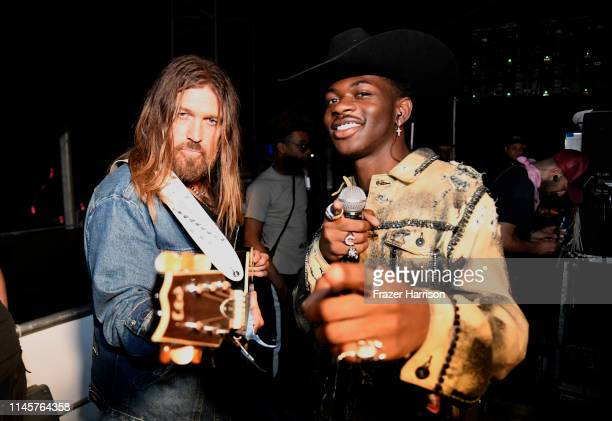 Billy Ray Cyrus and Lil Nas X pose backstage during the 2019 Stagecoach Festival at Empire Polo Field on April 28 2019 in Indio California