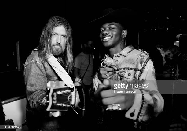 Billy Ray Cyrus and Lil Nas X pose backstage during the 2019 Stagecoach Festival at Empire Polo Field on April 28, 2019 in Indio, California.