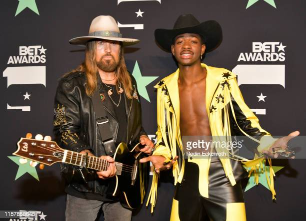 Billy Ray Cyrus and Lil Nas X pose for a portrait at the 2019 BET Awards on June 23 2019 in Los Angeles California
