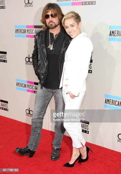 Billy Ray Cyrus and Miley Cyrus attend the 2013 American Music Awards at Nokia Theatre L.A. Live on November 24, 2013 in Los Angeles, California.
