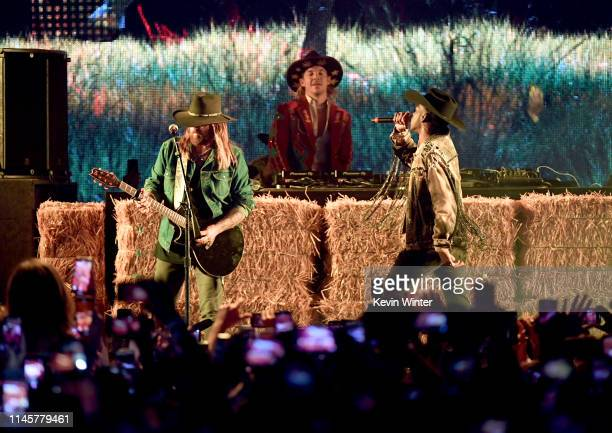 Billy Ray Cyrus Diplo and Lil Nas X perform onstage during the 2019 Stagecoach Festival at Empire Polo Field on April 28 2019 in Indio California