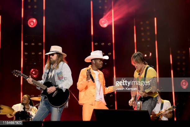 Billy Ray Cyrus Lil Nas X and Keith Urban perform onstage during day 3 of the 2019 CMA Music Festival on June 8 2019 in Nashville Tennessee