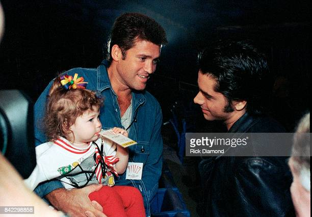 Billy Ray Cyrus Miley Cyrus and John Stamos attend Elvis The Tribute at The Pyramid Arena in Memphis Tennessee October 08 1994