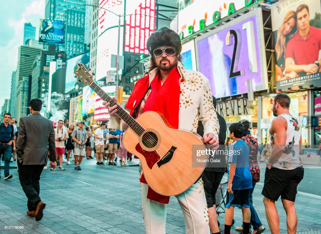 Billy Ray Cyrus performs as Burnin Vernon Brown in Times Square to promote the season two premiere of 'Still The King' airing July 11 at 10/9c on CMT, on July 10, 2017 in New York City.