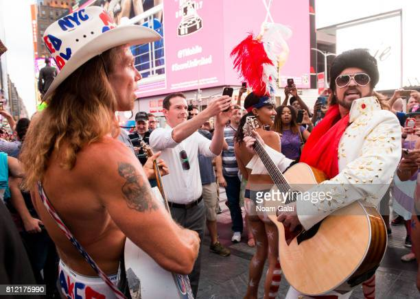 Billy Ray Cyrus performs as Burnin Vernon Brown with The Naked Cowboy in Times Square to promote the season two premiere of 'Still The King' airing...