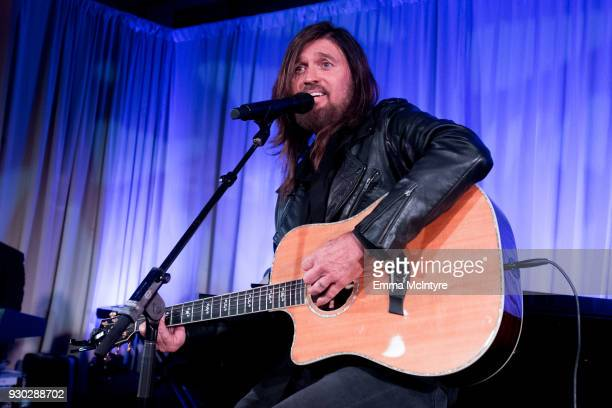 Billy Ray Cyrus performs onstage at the Celebrity Fight Night's Founders Club Dinner on March 9 2018 in Phoenix Arizona