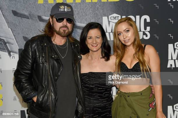Billy Ray Cyrus Senior Vice President of Music Strategy for CMT Leslie Fram and Brandi Glenn Cyrus attend the 2017 CMT Music awards at the Music City...