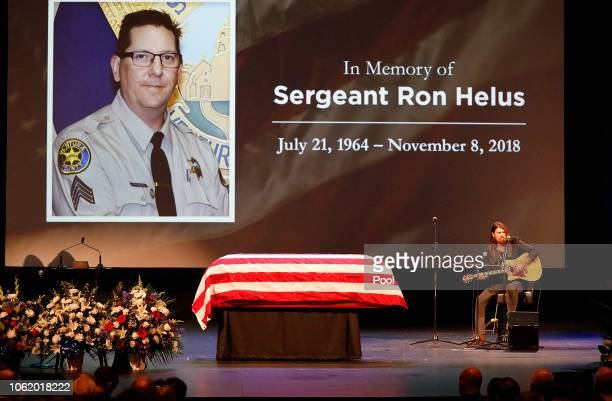 Billy Ray Cyrus sings during the memorial service for Sgt Ron Helus at Calvary Community Church on November 15 2018 in Westlake Village California...