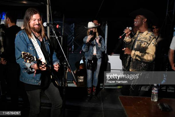 Billy Ray Cyrus Tish Cyrus and Lil Nas X backstage during the 2019 Stagecoach Festival at Empire Polo Field on April 28 2019 in Indio California
